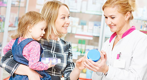 Pharmacist helping a lady and baby